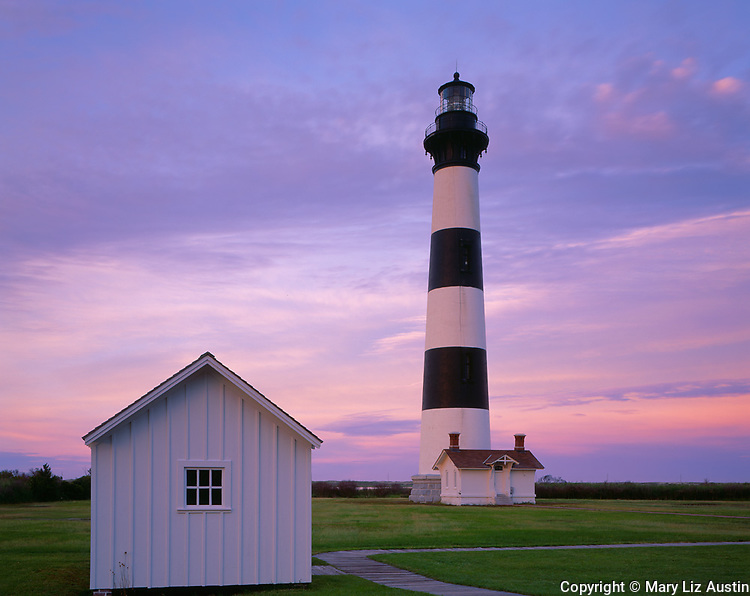 Cape Hatteras National Seashore, NC    <br /> Bodie Island Lighthouse (1872) with pastel colored clouds at dusk.  Outer Banks of Norht Carolina
