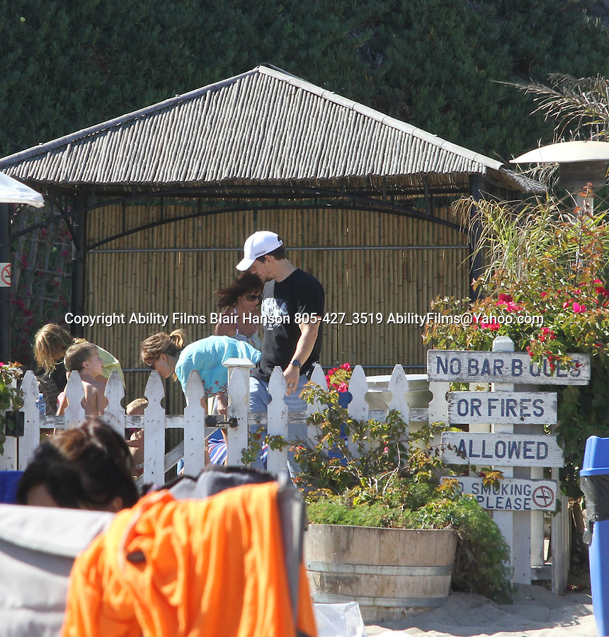 September 3rd 2011  Exclusive ...Mark Wahlberg rented out a beach Cabana for the day at Paradise Cove in Malibu California with his wife & kids. Mark gave his wife a big kiss goodbye & left with a friend a few hours before his wife did. Mark was wearing a weird shirt with a bunch of hands on it & didn't even take off his shirt ..AbilityFilms@yahoo.com.805-427-3519.www.AbilityFilms.com.