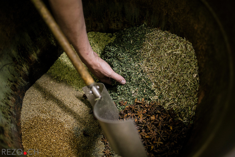 Christophe Racine at his distillery in M&ocirc;tiers preparing one of his absinthe. Preparation of absinth involves different herbs (small and big woodworm, hyssop, anise, fennel, licorice, mint, coriander, melissa, angelica), dosage and presence of the different plants may vary from one reciepe to the other. Then, mr. Racine adds alcohol and water to the mix, leave it macerate for one day and distil it the next day.<br /> <br /> Credits: Niels Ackermann / Rezo.ch