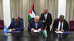 Palestinian Prime Minister Mohammad Ishtayeh attends the signing ceremony with the World Bank and French development agency to support the Palestinian municipalities, in the West Bank city of Ramallah, June 17, 2019. Photo by Prime Minister Office