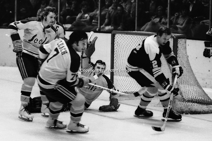 California Golden Seals action, Dick Redmond, Reggie Leach, and goalie Gilles Meloche. defend #12 Wayne Cashman. (photo/Ron Riesterer)