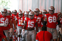 Ohio State Buckeyes running back Ezekiel Elliott (15) and the Buckeyes walk out for warmups before in Ohio Stadium for their game against Hawaii at Ohio Stadium on September 12, 2015.  (Dispatch photo by Kyle Robertson)