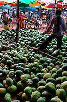 Watermelons at Siem Reap Morning Market - a large collection of indoor and outdoor stalls selling all types of goods. The market starts up at sunrise and remains open until around noon. There you will find grains, fish, tropical fruit and a glimpse into the real Cambodia.