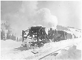 K-27 #461 pushes Jordan spreader past depot.<br /> D&amp;RGW  Cumbres Pass, CO  Taken by Lively, Charles R.