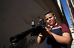 Palestinian boys play with toy guns to celebrate Eid al-Fitr during the second day of the holiday of Eid al-Fitr marking the end of Islam's fasting holy month of Ramadan, in the West Bank city of Nablus, on July 7, 2016. Photo by Nedal Eshtayah