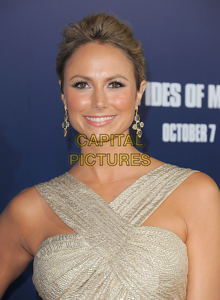 Stacy Keibler.The L.A. Premiere of 'The Ides of March' held at The Academy of Motion Picture Arts & Sciences  in Beverly Hills, California, USA..September 27th, 2011.headshot portrait beige silver gold smiling dangling earrings .CAP/RKE/DVS.©DVS/RockinExposures/Capital Pictures.