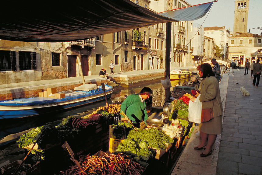 Fresh Produce being sold by a vendor in a boat. Venice, Italy Canal.