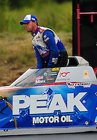 Sept. 17, 2011; Concord, NC, USA: NHRA top fuel dragster driver T.J. Zizzo during qualifying for the O'Reilly Auto Parts Nationals at zMax Dragway. Mandatory Credit: Mark J. Rebilas-US PRESSWIRE