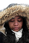 Leona Tolliver of Cincinnati, OH, sheds a tear as she watches the Second Inauguration of President Barack Obama from the National Mall on Jan. 21, 2013.
