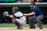 Catcher Brian Peterson #26 of the Louisville Bats and home plate umpire Kevin Causey at Knights Stadium June 23, 2009 in Fort Mill, South Carolina. (Photo by Brian Westerholt / Four Seam Images)