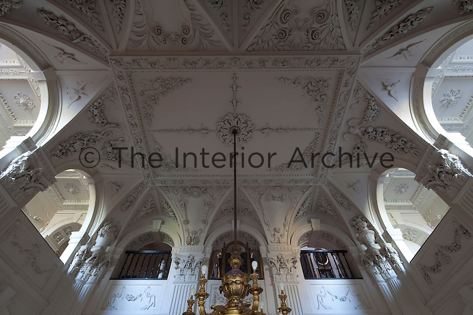 The entrance hall, inspired by Vanbrugh's marble hall at Castle Howard, is decorated with ornate plasterwork stucco foliage which took the craftsman Josef Enzer six years to make