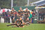 Vernon Comley trips over the sliding Ioane Ioane in the wet and muddy conditions. Counties Manukau Premier Club Rugby game between Patumahoe and Bombay played at the Patumahoe Domain on Saturday June 4th 2011 as part of the Patumahoe 125th Anniversary celebrations. Patumahoe won 24 - 3 after leading 5 - 3 at halftime.