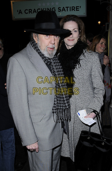 "SIR PETER HALL & NIKKI FREI.The ""Clybourne Park"" press night, Wyndham's theatre, Charing Cross Rod., London, England..February 8th, 2011.half length grey gray suit coat hat black scarf married husband wife houndstooth.CAP/CAN.©Can Nguyen/Capital Pictures."