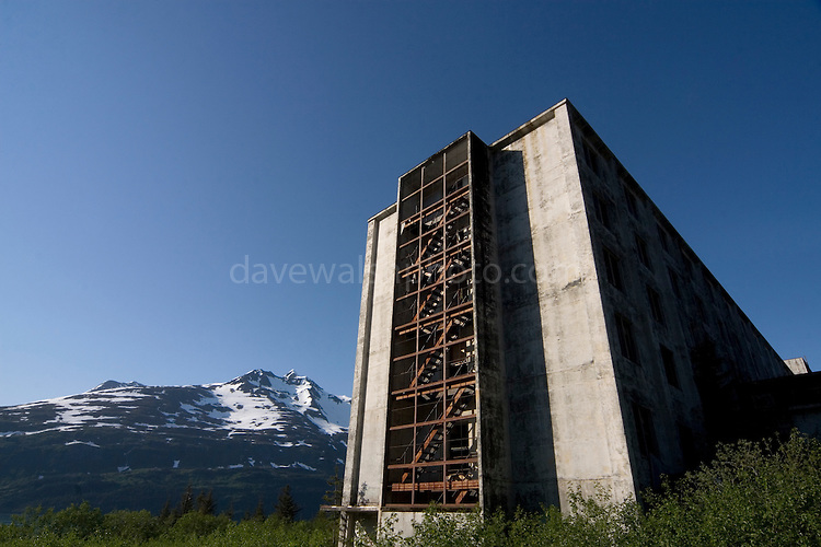 "The Buckner Building, Whittier, Alaska - ""A city under one roof"". Built in 1953, this derelict building was abandoned but can't be demolished due to the amount of asbestos inside. It was damaged by earthquake in  1964.....The strangest town in Alaska, Whittier - only reachable by tunnel or ship. It's a stop off point for Cruise ships, and the Alaska raildroad. 90% of inhabitants live in one building! Originally established as a military base during World War two....."