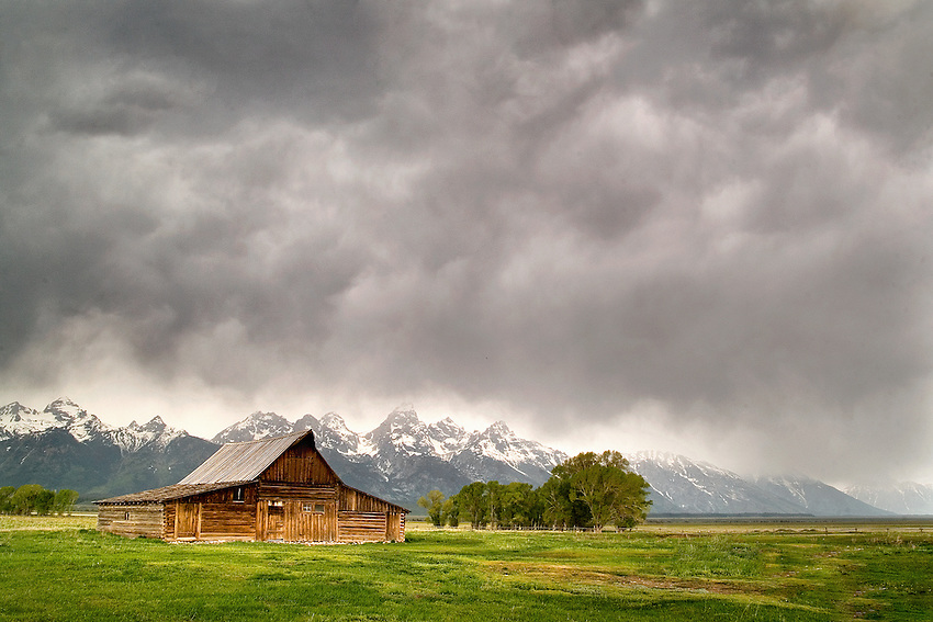 """MORMONS STORM"" -- A summer thunderstorm rolls in over Mormons Row in Grand Teton National Park. Wyoming."