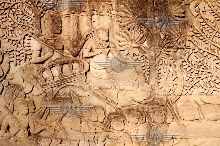 A bas relief of elephants and warriors on the East Outer Gallery at the Bayon Temple, Ankor Wat.