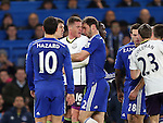 Tempers flare between Chelsea's Branislav Ivanovic and Everton's James McCarthy as they clash heads<br /> <br /> Barclays Premier League- Chelsea vs Everton  - Stamford Bridge - England - 11th February 2015 - Picture David Klein/Sportimage
