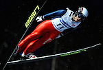 YONG-JIK CHOI of South Korea soars through the air during the FIS World Cup Ski Jumping in Sapporo, northern Japan in February, 2008.