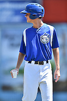 Asheville Tourists bat boy Bryce Ballew during a game against the Charleston RiverDogs at McCormick Field on July 10, 2016 in Asheville, North Carolina. The Tourists defeated the RiverDogs 4-2. (Tony Farlow/Four Seam Images)