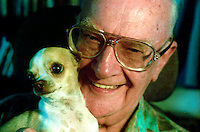 "Arthur C. Clarke with his dog, Pepsi, at his home in Sri Lanka in 1996. He is perhaps most famous for being co-writer of the screenplay for the movie 2001: A Space Odyssey, considered by the American Film Institute to be one of the most influential films of all time. His other science fiction writings earned him a number of Hugo and Nebula awards, along with a large readership, making him into one of the towering figures of the field. For many years he, along with Robert Heinlein and Isaac Asimov, were known as the ""Big Three"" of science fiction. Clarke died in 2008 at age 90."