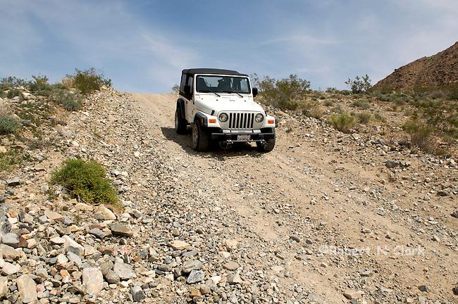 Jeep Wrangler on desert dirt road