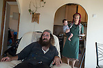 Natanel with his wife Milka and son at their house, in the unauthorized Israeli settler-outpost of Chavat Gilad, West Bank.