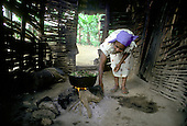 Cooking beans in the outhouse kitchen of a house in the mountain village of Montesita