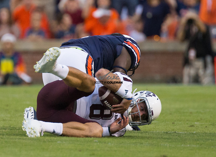 Auburn Tigers defensive tackle Montravius Adams (1) sacks Texas A&M Aggies quarterback Trevor Knight (8) during the first half of an NCAA college football game between the Auburn Tigers and the Texas A&M Aggies at Jordan Hare Stadium in Auburn, Alabama on September 17, 2016.