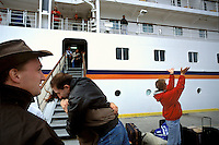 European cruise boat travelers bid farewell to fellow passengers in Ushuaia as they disembark to continue their adventures in Patagonia. Though their numbers can inundate local infrastructure and fuel hurried development, tourists have also helped many Fueguians see the economic advantages of their glaciers, forests and mountains. Pro-development governments have been slowed by grassroots environmental movements hoping to preserve regional wilderness for its own sake as well as for its potential as a tourist draw.
