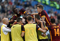 Calcio, Serie A: Roma vs Lazio. Roma, stadio Olimpico, 8 novembre 2015.<br /> Roma's Gervinho is hidden by teammates' hugs after scoring during the Italian Serie A football match between Roma and Lazio at Rome's Olympic stadium, 8 November 2015.<br /> UPDATE IMAGES PRESS/Isabella Bonotto