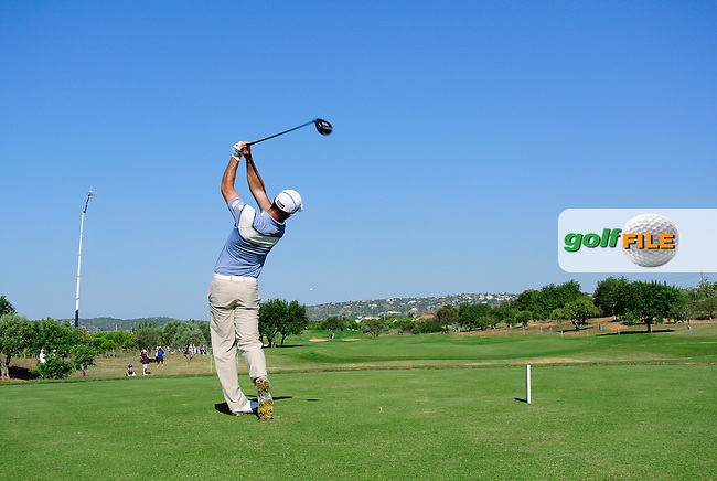 Ricardo Santos (POR) tees off the 3rd tee during Thursday's Round 1 of the 2013 Portugal Masters held at the Oceanico Victoria Golf Club. 10th October 2013.<br /> Picture: Eoin Clarke www.golffile.ie