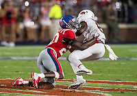 NWA Democrat-Gazette/BEN GOFF @NWABENGOFF<br /> Keidron Smith, Ole Miss cornerback, tackles Mike Woods, Arkansas wide receiver, for a loss in the third quarter Saturday, Sept. 7, 2019, at Vaught-Hemingway Stadium in Oxford, Miss.