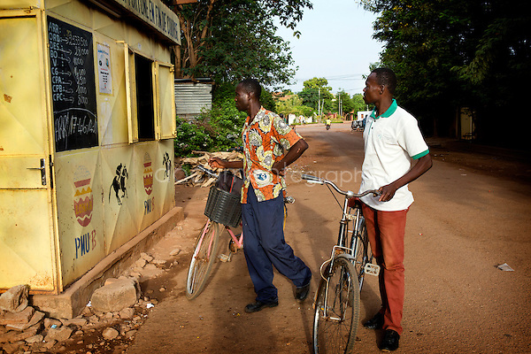 Once open, the 'PMU club' sees men on bykes, motorbykes or even cars approaching shily next to the external black board hopping to be lucky. Here two men are exchanging their bet ticket from last day race. 'Sometimes we lost, sometimes we gain' whispers Alain, a diligent bettor.