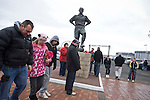 Middlesbrough 1 Preston North End 1, 22/01/2011. Riverside Stadium, Championship. Supporters gather beneath a statue of former player George Hardwick outside Middlesbrough FC's Riverside Stadium on the day the club played host to Preston North End in an Npower Championship fixture. The match ended in a one-all draw watched by a crowd of 16,157. Middlesbrough relocated from their former home at Ayresome Park in 1995. Photo by Colin McPherson.