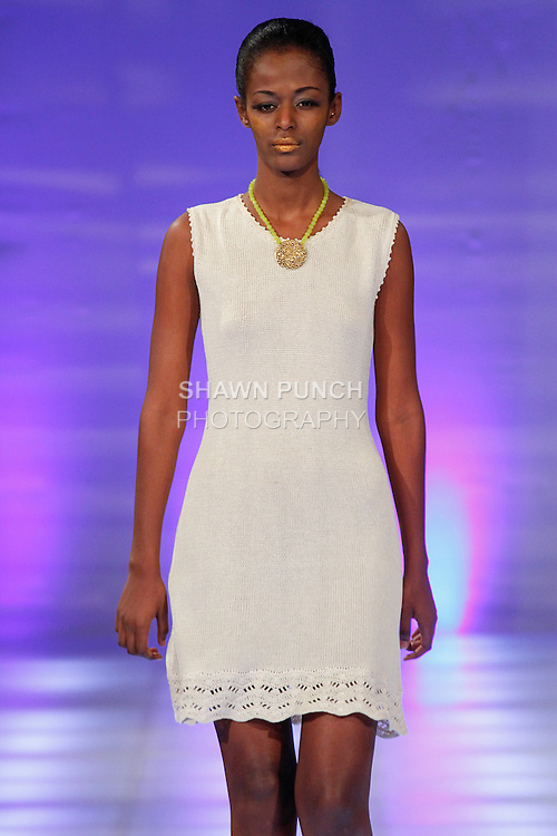 Model walks runway in knitwear from the Janerations Couture Spring 2014 collection by Janina Stankiene, during Couture Fashion Week, September 8, 2013.