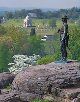 Gettysburg National Military Park, PA<br /> Statue of Brig. Gen. Warren on Little Round Top overlooking the Pennsylvania Memorial and Gettysburg battlefield