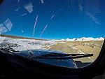 Car on alpine plateau, Tien Shan Mountains, eastern Kyrgyzstan