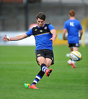 Adam Hastings of Bath Rugby practises his place-kicking during the pre-match warm-up. West Country Challenge Cup match, between Gloucester Rugby and Bath Rugby on September 13, 2015 at the Memorial Stadium in Bristol, England. Photo by: Patrick Khachfe / Onside Images