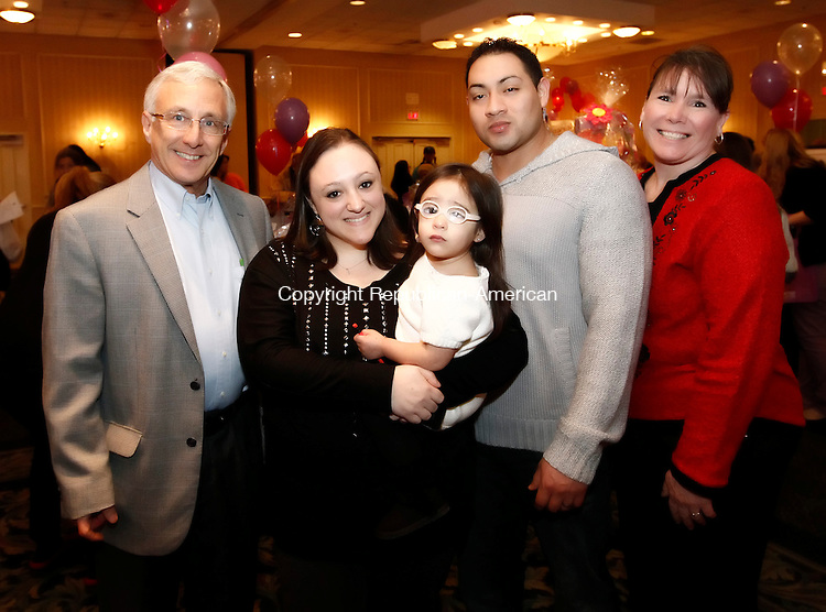 Southbury, CT-03 February 2012-020313CM15- SOCIAL MOMENTS:  From left to right, Francis DeBlasio, President and CEO of Easter Seals, Amanda, Kaydence, 2, (Easter Seals Ambassador 2013) and Julio Rincon, of Waterbury and Mary Reid, Events Administrator photographed during the 20th annual Chocolate Lovers' Expo to benefit Easter Seals, at the Crowne Plaza Hotel in Southbury.  Christopher Massa Republican-American