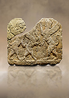 Hittite relief sculpted orthostat stone panel of Herald's Wall Limestone, Karkamıs, (Kargamıs), Carchemish (Karkemish), 900-700 B.C. Anatolian Civilisations Museum, Ankara, Turkey.<br /> <br /> Two sphinxes standing on their hind legs on both sides attack to the winged horse standing on its hind legs in the middle.  <br /> <br /> Against a brown art background.