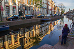 Woman visiting canal in Leiden, Netherlands .  John offers private photo tours in Denver, Boulder and throughout Colorado, USA.  Year-round. .  John offers private photo tours in Denver, Boulder and throughout Colorado. Year-round.