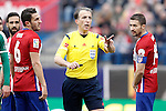 Spanish referee Fernandez Borbalan in presence of Atletico de Madrid's Koke Resurrecccion (l) and Gabi Fernandez during La Liga match. February 6,2016. (ALTERPHOTOS/Acero)