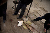 A Muslim man butchers a freshly-killed goat in Linxia, Gansu Province, China.
