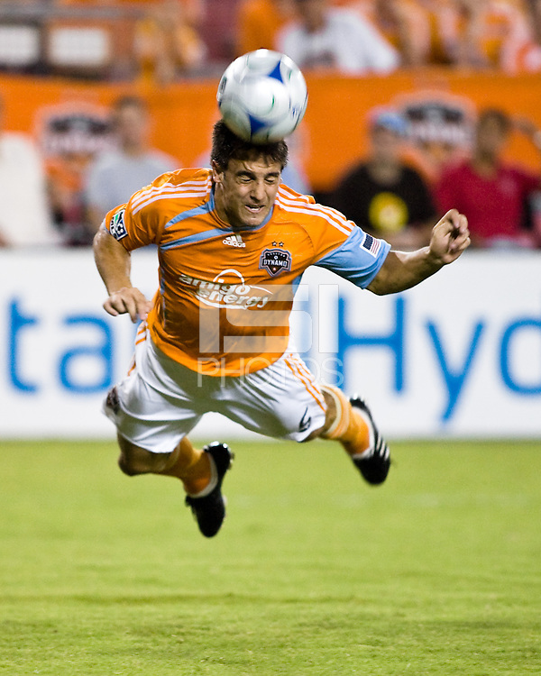 Houston Dynamo midfielder Danny Cruz (5) makes a diving header.  New England Revolution defeated Houston Dynamo 1-0 at Robertson Stadium in Houston, TX on July 25, 2009.