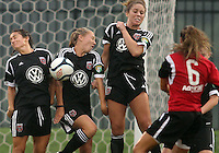 BOYDS, MARYLAND - July 21, 2012:  Molly Menchel (14), Hayley Siegel (12) and Jerica DeWolfe (20) of DC United Women block a free kick from Emily Kittleson (6) of the Virginia Beach Piranhas during a W League Eastern Conference Championship semi final match at Maryland Soccerplex, in Boyds, Maryland on July 21. DC United Women won 3-0.
