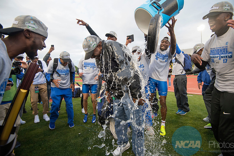EUGENE, OR - JUNE 09: Head Coach Mike Holloway of the University of Florida is doused with water during the Division I Men's Outdoor Track & Field Championship held at Hayward Field on June 9, 2017 in Eugene, Oregon.  Florida won the team national title. (Photo by Jamie Schwaberow/NCAA Photos via Getty Images)