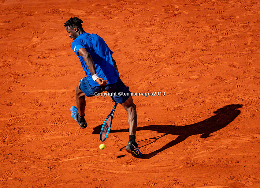 Paris, France, 1 june, 2019, Tennis, French Open, Roland Garros, Geal Monfils (FRA) hits the ball between his leggs a tweener<br /> Photo: Henk Koster/tennisimages.com
