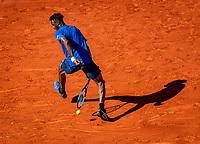 Paris, France, 1 june, 2019, Tennis, French Open, Roland Garros, Geal Monfils (FRA) hits the ball between his leggs a tweener<br /> Photo: Henk Koster/tennisimages.com