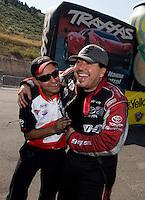 Jul. 21, 2013; Morrison, CO, USA: NHRA funny car driver Cruz Pedregon celebrates with his crew after winning the Mile High Nationals at Bandimere Speedway. Mandatory Credit: Mark J. Rebilas-