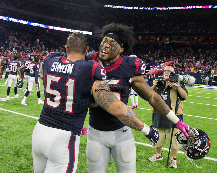 Houston Texans outside linebacker John Simon (51) and Houston Texans inside linebacker Benardrick McKinney (55) share a celebratory hug following an NFL game between the Houston Texans and the Indianapolis Colts at NRG Stadium in Houston, Texas. The Texans beat the Colts 26-23 in overtime.